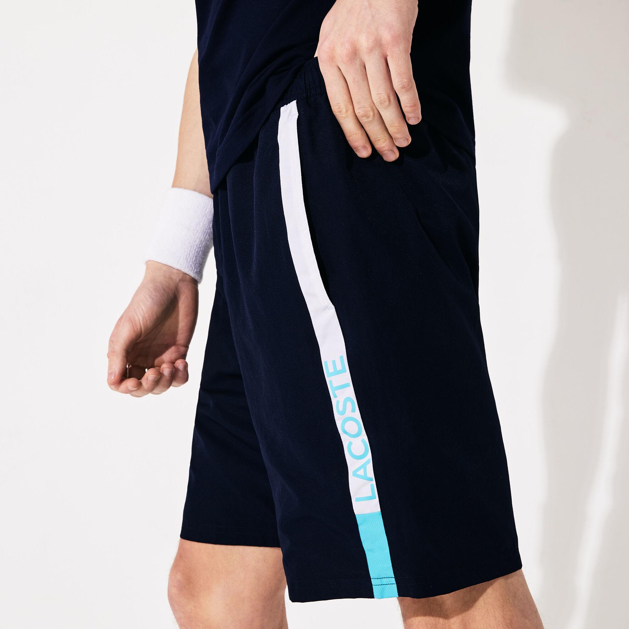 شورت من قماش خفيف مزدان بخطوط ذات ألوان متباينة من مجموعة Lacoste SPORT للرجال